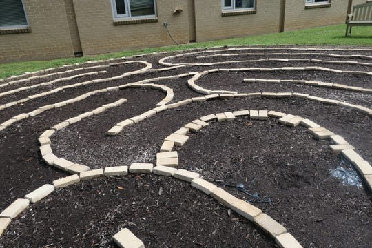 A detailed view of the Tennessee Valley Unitarian Universalist Church's labyrinth. Children designed and built the labyrinth using cream-colored brick pavers and mulched paths.