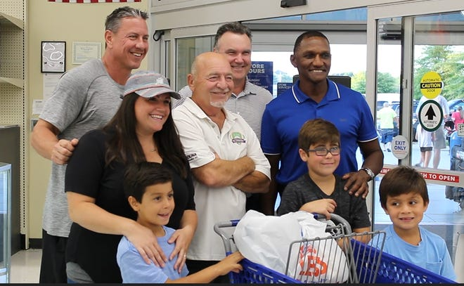 Former Atlanta Braves players Steve Avery, Greg McMichael, Otis Nixon and former pitching coach Leo Mazzone  pose for a photo at Academy Sports in Knoxville on Sunday, Sept. 30, 2018.