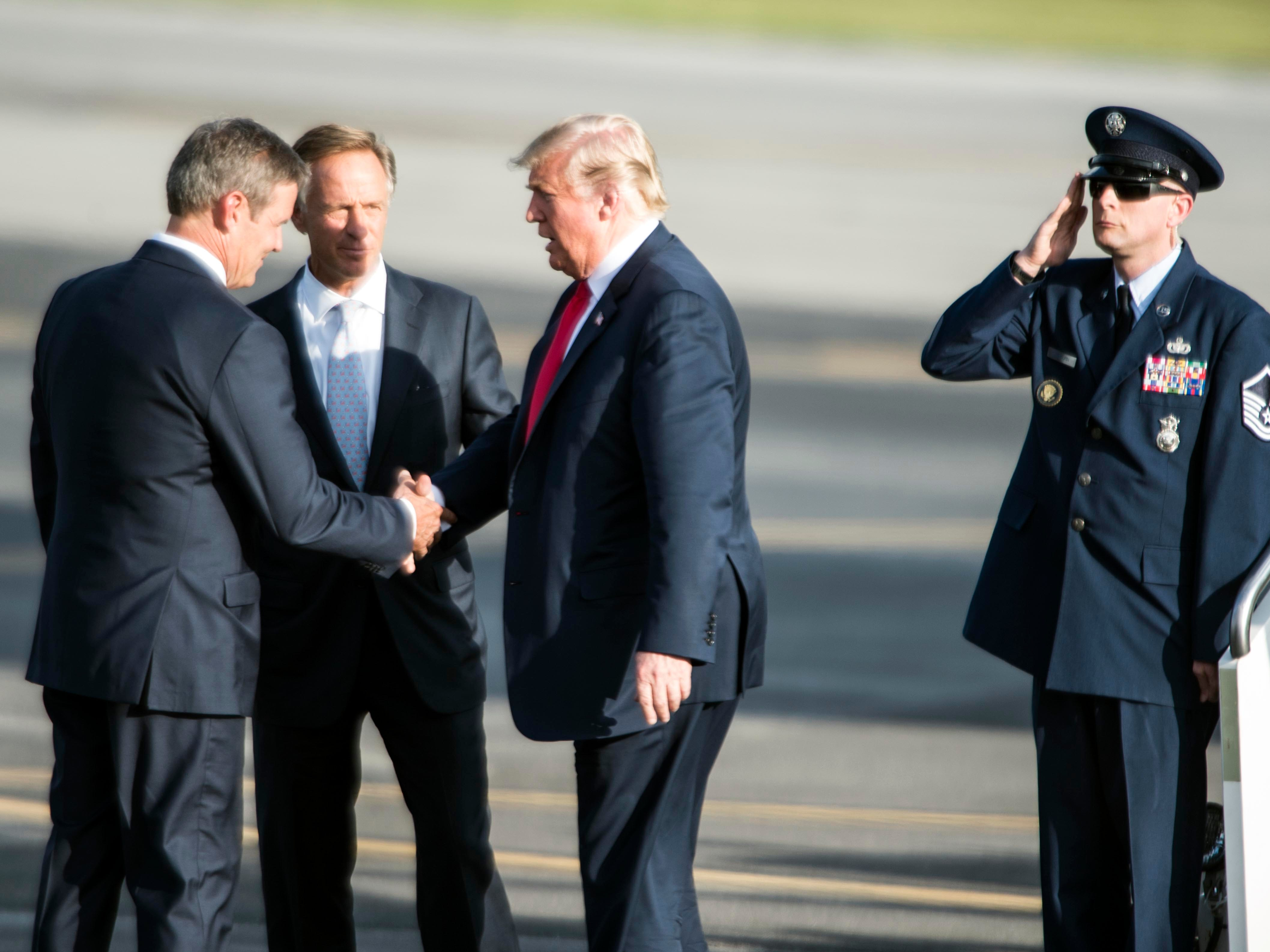 President Donald Trump greets Governor Bill Haslam and candidate for governor Bill Lee after arriving at Tri-City Aviation on Monday, October 1, 2018.