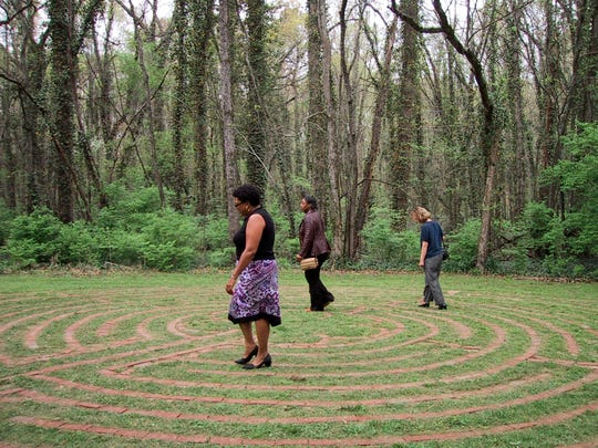 People walk Maryville College's labyrinth, located at the college's House in the Woods, after its 2005 dedication.