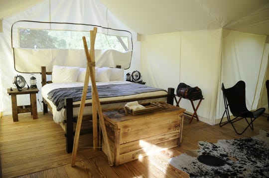 The tents are constructed on top of a wooden platform that also offers a front porch area.