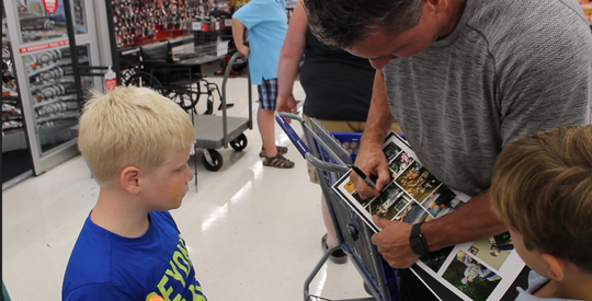 Former Atlanta Braves player pitcher Steve Avery signs an autograph at Academy Sports in Knoxville on Sunday, Sept. 30, 2018.