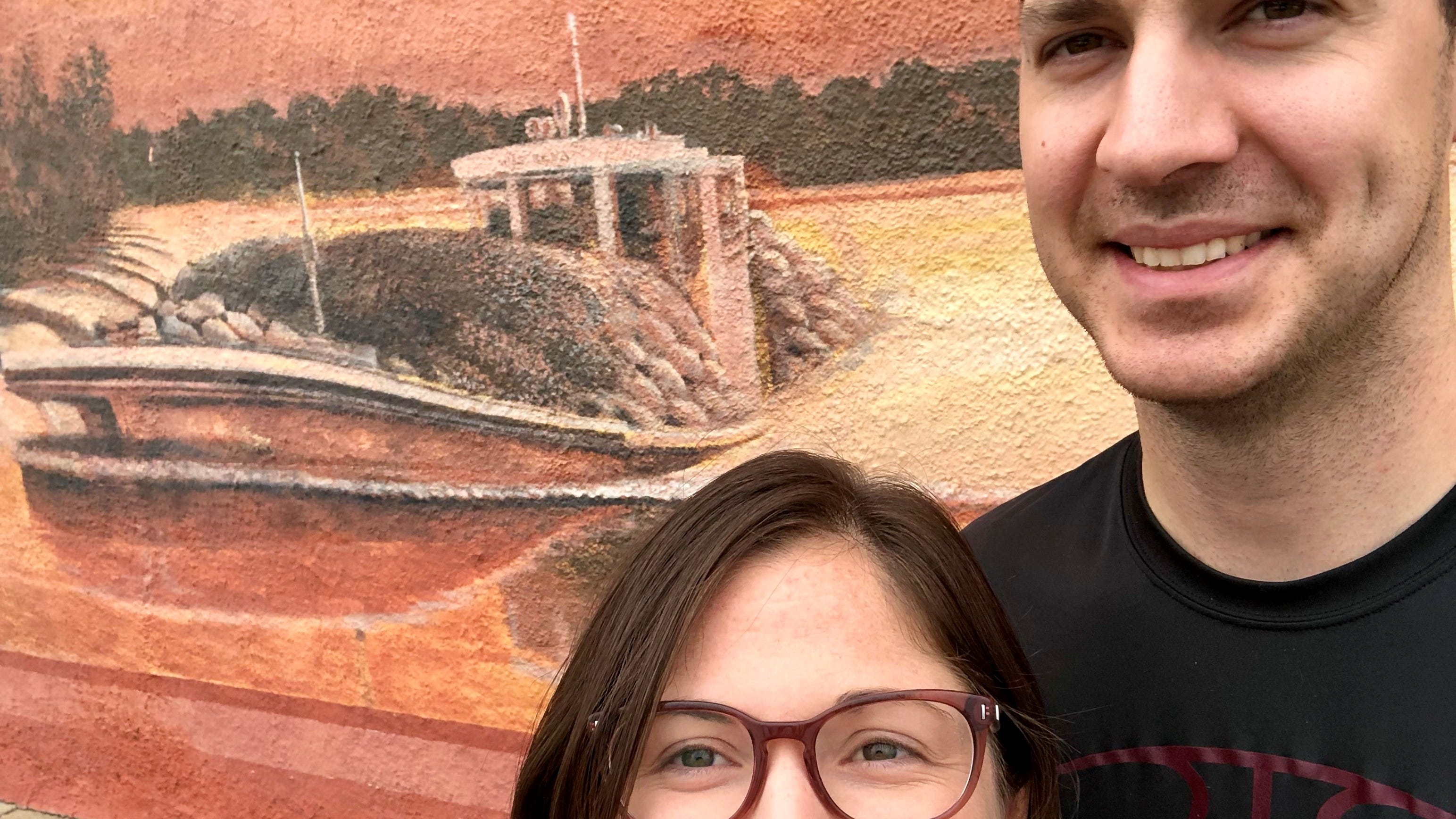 Travel and tourism reporter Leigh Guidry and family are following the Louisiana Byways routes that take visitors off the interstate and down the back roads. Here she and husband Eric stand in front of a mural in downtown Abbeville.