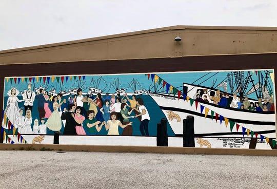 A mural depicts the Delcambre Shrimp Festival near the town docks.