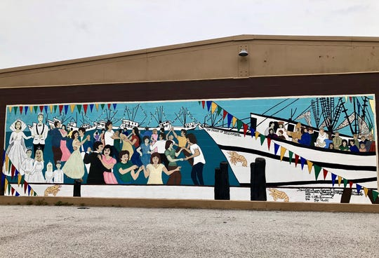 A mural depicts the Delcambre Shrimp Festival near the town docks.