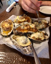 Charbroiled oysters are on the menu at Dupuy's Oyster Shop in downtown Abbeville.