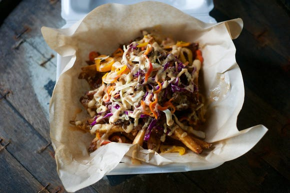 Graton Eatery in St. Martinville offers options like these brisket fries.