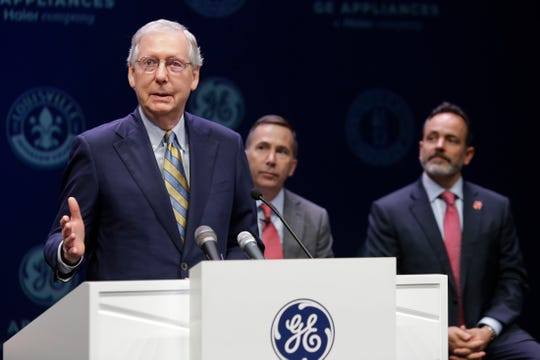 Senator Mitch McConnell spoke during an announcement that GE Appliances will invest 200 million dollars and create 400 new jobs at Appliance Park. Kevin Nolan, President and CEO of GE Appliances and Kentucky Governor Matt Bevin are on right. Oct. 1, 2018.