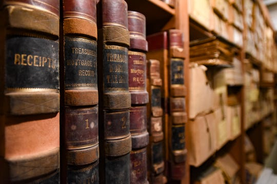 Old books and paperwork in the vaults at the 1873 Eaton County Sheriff's Residence in Charlotte.