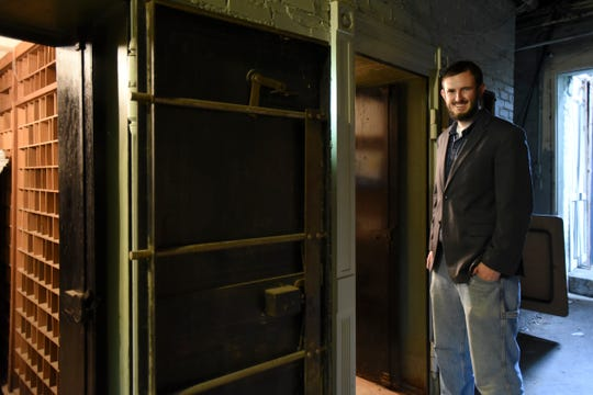 Jonathan Potter of PotterVilla Applied Technology runs his computer business out of the former Sheriff's residence in Charlotte.   One of his favorite places in the historic building are the vaults in the basement.
