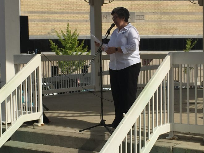 Kathy Ezawa, executive director of the Domestic Violence Shelter, addresses the crowd Monday at the kickoff for Domestic Violence Awareness Month.