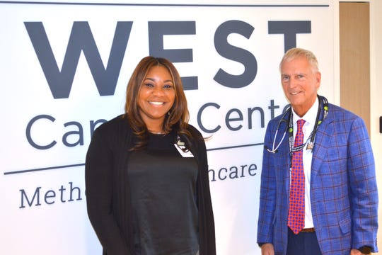 Keesha Green, community outcomes and relations coordinator at West Cancer Center, and Dr. Kurt Tauer, chief of staff for medical oncology at West Cancer Center, smile after discussing improvements in getting more African-American women in Memphis to get mammograms.