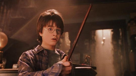"They grow up so fast: Not unlike a symphony conductor, Daniel Radcliffe waves a wand and creates magic in ""Harry Potter and the Sorcerer's Stone,"" which screens Saturday and Sunday at the Orpheum with live accompaniment from the Memphis Symphony Orchestra."