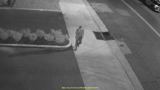 Surveillance video shows Phil Trenary walking on South Front Street prior to being shot on Sept. 27.