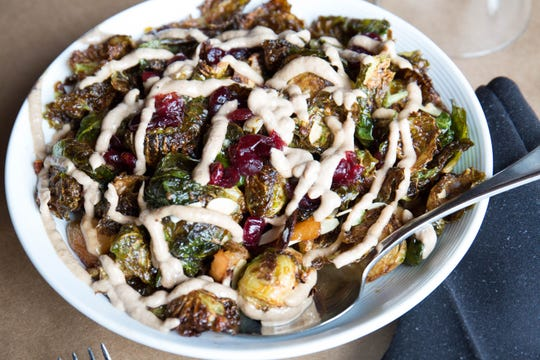 Crisp Brussels is one of the most popular sides at Bounty on Broad. Roasted apples, pickled cranberries, toasted almonds, bacon and walnut aioli  are some of the ingredients that makes chef Russell Casey's dish so unique.