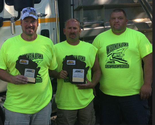 West Allis had three snow plow drivers in the top 10 in the Wisconsin Snow Roadeon that attracted 120 drivers from all over Wisconsin. The winners are (from left) Scott Travers, fourth place; Henry Teetz III, first place; and Gary Banaszynski, eighth place. Teetz went on to the national competition to win 12th place.