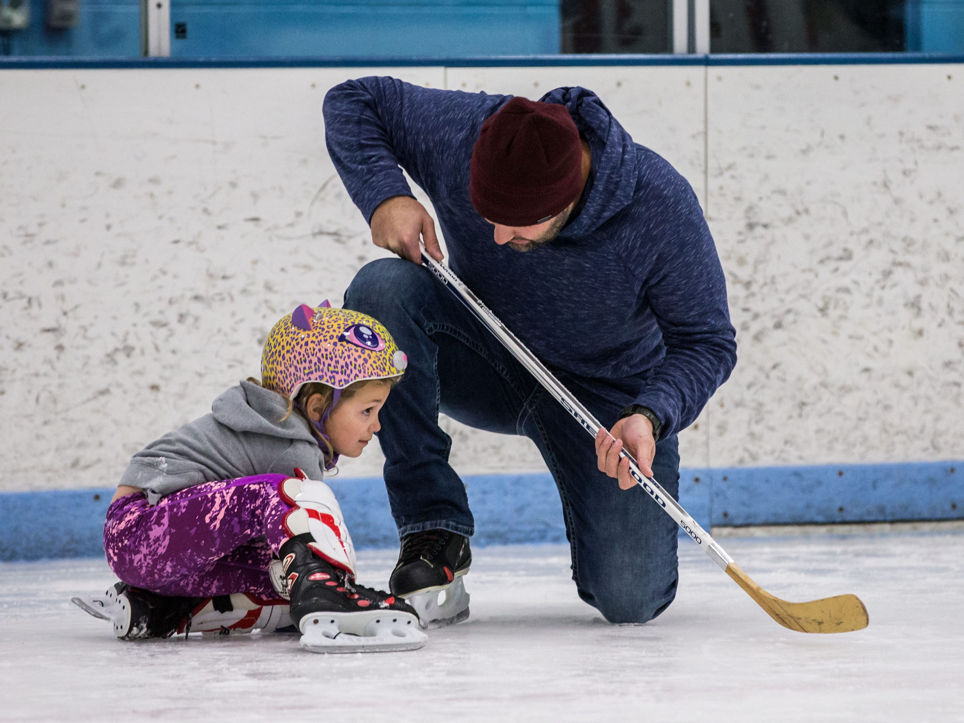 Jackson Davis of Pewaukee gives words of encouragement as his 4-year-old daughter Charlie finds her footing during the Girls Try Hockey for Free event at Eble Park Ice Arena in Brookfield on Sunday, Sept. 30, 2018. The Waukesha County Wolves all girls hockey organization hosted the event.