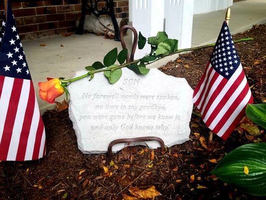 A long-stem orange rose lays over a memorial plaque which rests outside of Richard and Mary Berger's Brookfield home. The couple remembered their son Stephen who died in the Las Vegas shooting a day after his birthday.