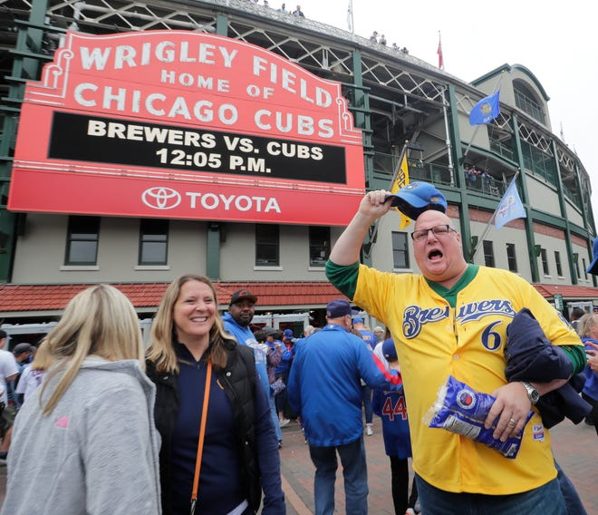 Brewers fan Brett Lieungh lets out a cheer outside of Wrigley Field before Milwaukee took on the Cubs in a game that decided the NL Central Division winner on Monday.