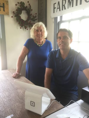 Pat Leverence (left) and her son Paul Leverence celebrate 25 years of Lynndale Farm being the premier place to buy home decor in Lake Country.