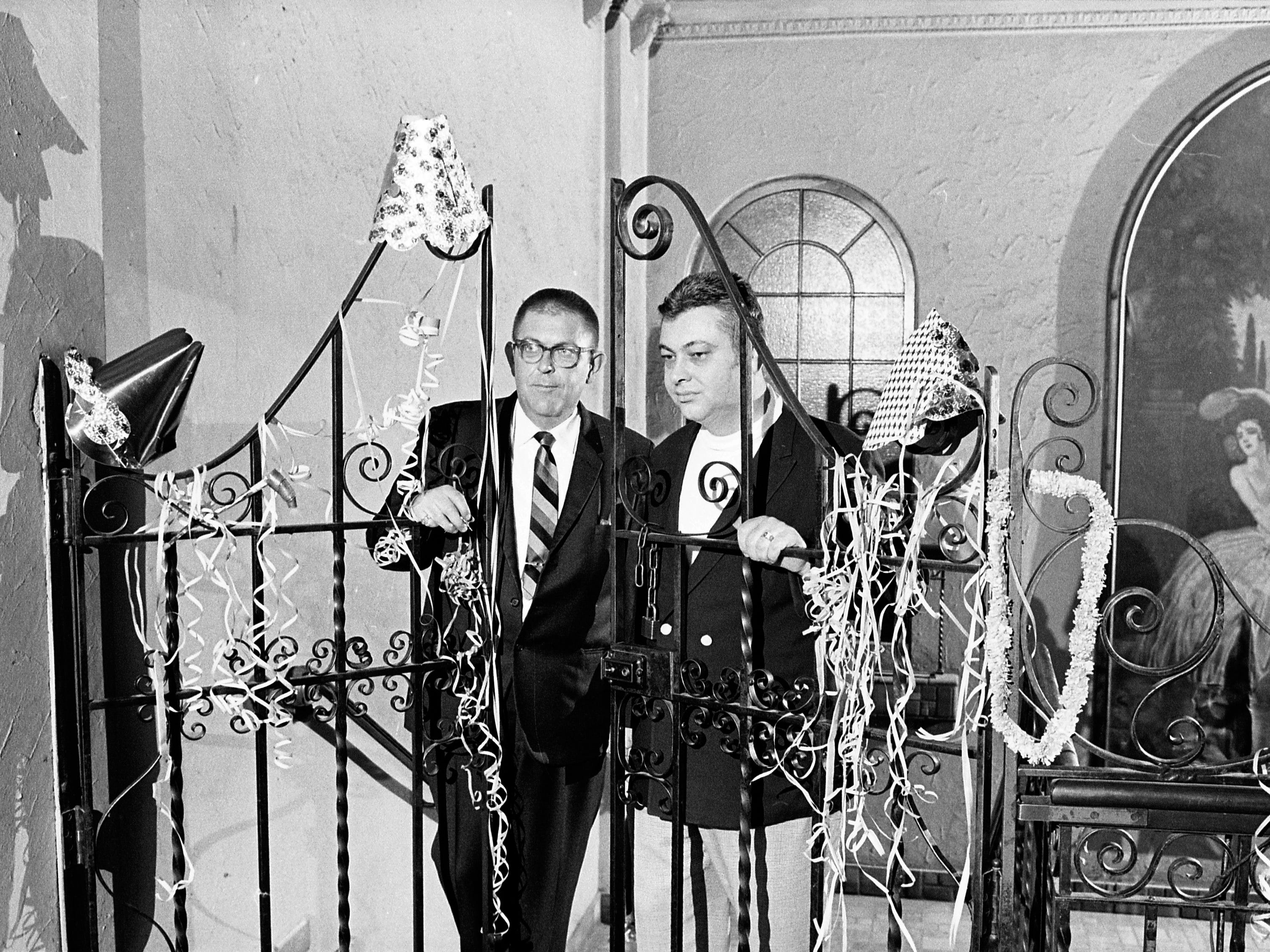 Robert Devine (left) closes the gates on Devine's Million Dollar Ballroom, 2401 W. Wisconsin Ave., on Feb. 25, 1968. The ballroom, for decades one of Milwaukee's top dance venues, closed its doors after 34 years because of declining business. The Eagles Club, which owned the building, reopened the ballroom in October 1968.