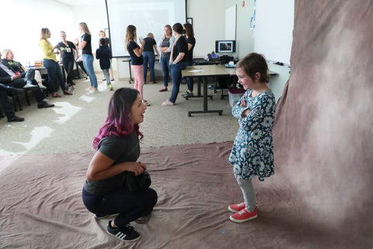 Photographer Sylvia Laughrin (left) chats with Giavanna Danninger, 6, at the start of a photo session. Children's Hospital of Wisconsin is participating in a national effort to photograph every child in the nation with pediatric cancer. Laughrin, of Milwaukee, volunteered to photograph the children.