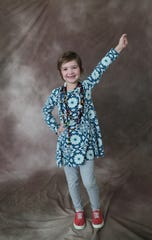 Giavanna Danninger, 6, strikes her superhero pose to celebrate one year since her bone marrow transplant. Children's Hospital of Wisconsin is participating in a national effort to photograph every child in the nation with pediatric cancer.