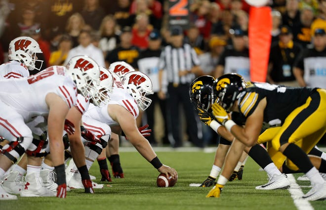 The Wisconsin Badgers deployed a 'Jumbo' package in which they utilized seven offensive linemen against the Iowa Hawkeyes on several plays.