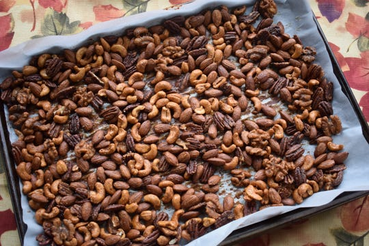 Pumpkin pie spice lends a fall flavor to spiced nuts.