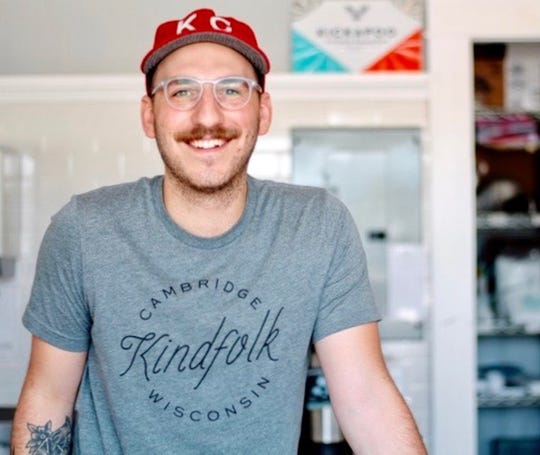 Owner Christopher Castrova loves getting to know his customers at Kindfolk Coffee Co. in downtown Cambridge.
