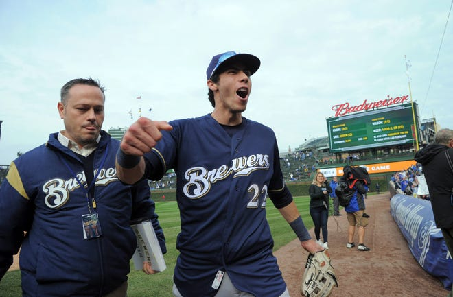 A jubilant Christian Yelich leaves the field after the Brewers defeated the Cubs, 3-1, on Monday to win the NL Central Division title.