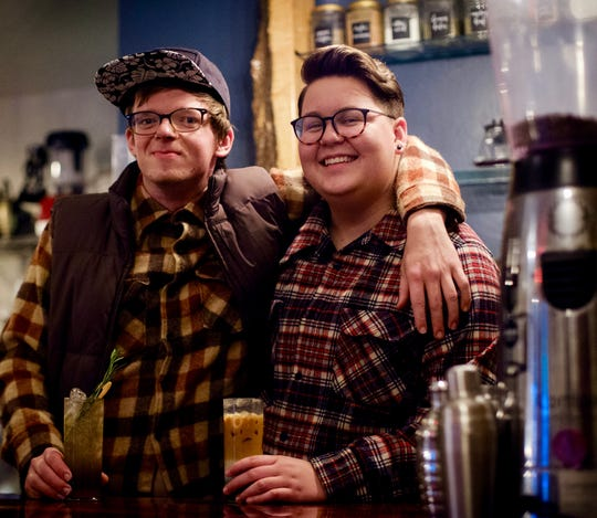Owner Ryan Castelaz (left) and lead barista Myles Parenteau enjoy a Rotating Fall Soda and Iced Military Latte, respectively, at Discourse Coffee in Sister Bay.