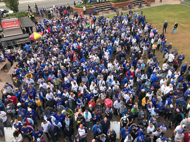 The line of fans waiting to get into the Brewers-Cubs game at Wrigley Field was still huge 10 minutes after the game started Monday. Mostly Cubs fans?