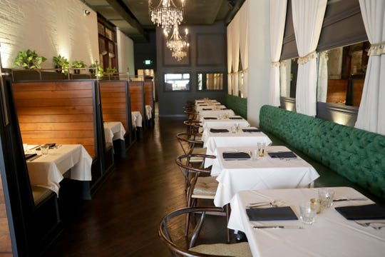 Tablecloths, curtains, upholstered seating and a ceiling that softens sound help take the sharp edge off of noise in the dining room at Fauntleroy, 316 N. Milwaukee St.