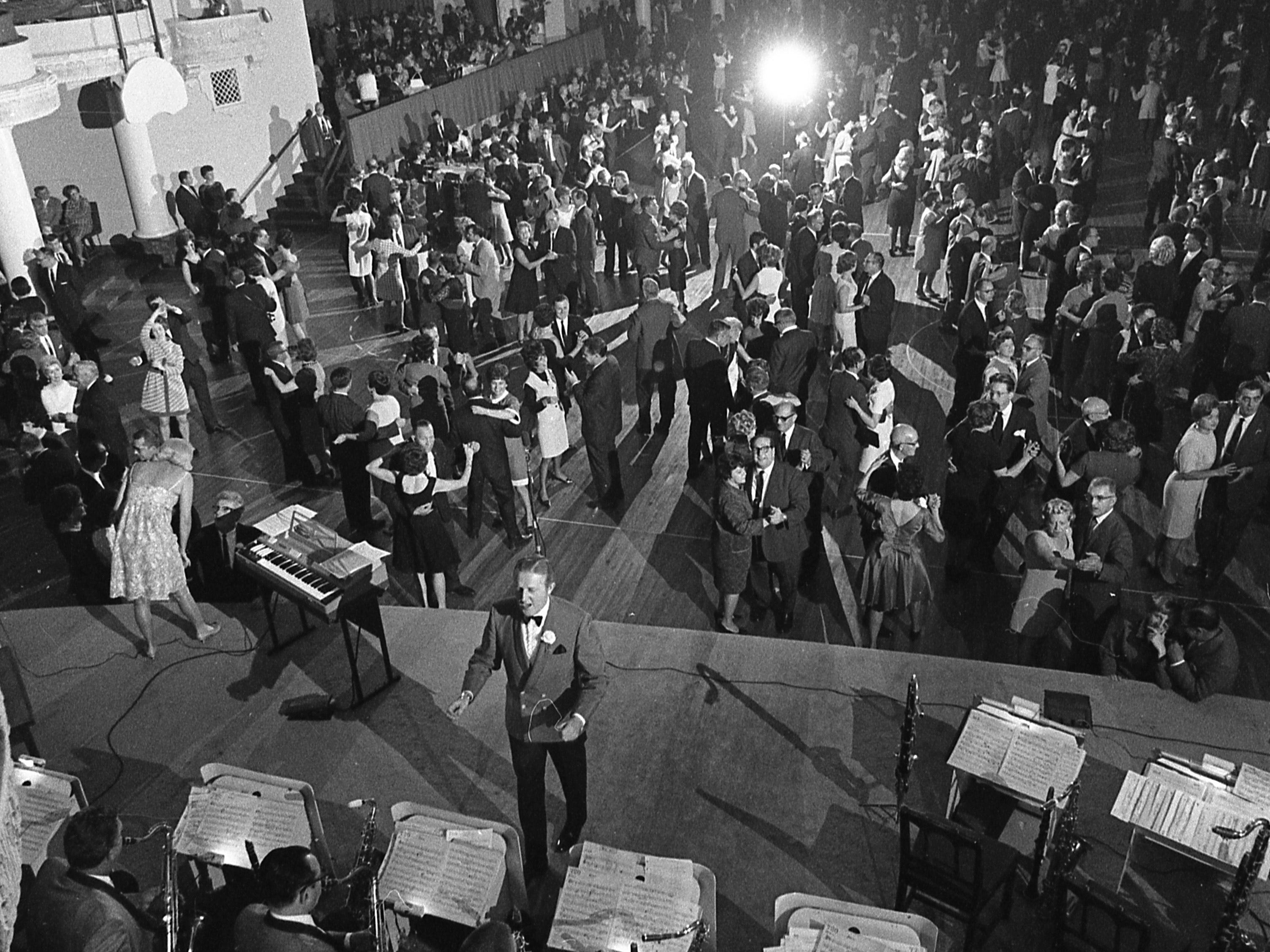 About 4,500 people turn out for the reopening of the Eagles Million Dollar Ballroom on Oct. 3, 1968. The ballroom in the Eagles Club, 2401 W. Wisconsin Ave., had been operated by the Devine family since 1934; it was closed in February 1968 because of fading business. The Eagles Club took over management of the facility, with Wayne King and his Orchestra the reopening-night headliner. This photo was published in the Oct. 4, 1968, Milwaukee Journal.
