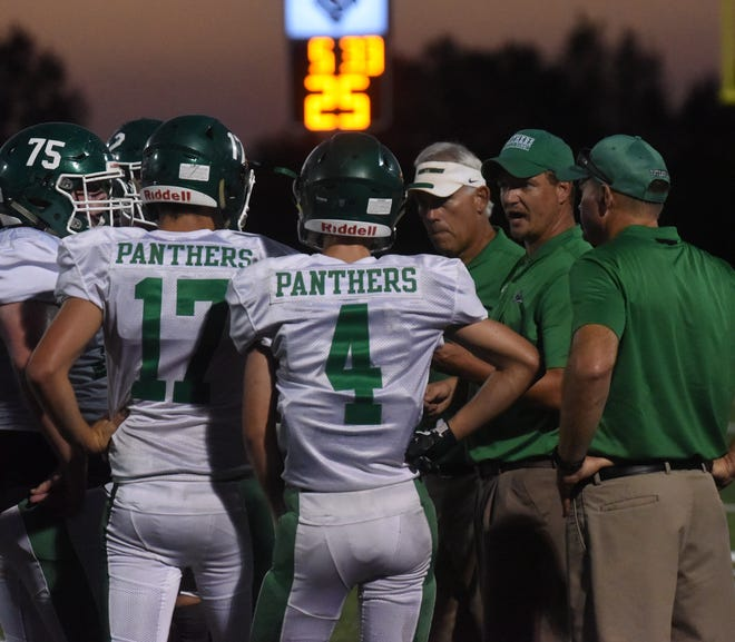 Yellville-Summit head coach Lucas Morris talks to the Panthers during a recent game.