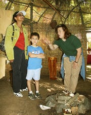 Lenape Day at the Great Swamp--Mayani Johnson with her son, Alex, 6, (they are from Harding Twp) listening to Jenny Gaus-Myers, superintendent of Environmental Education at the Great Swamp, talk about living in a teepee.