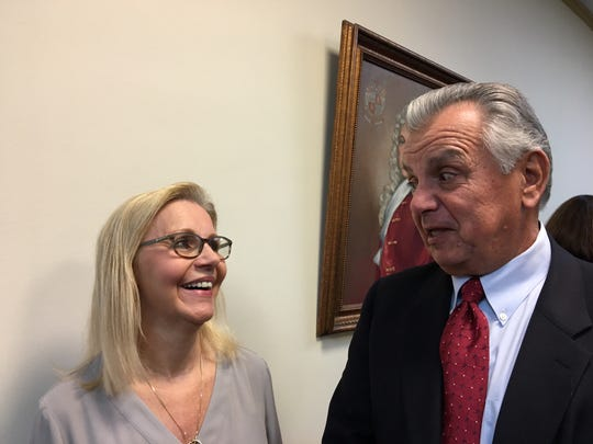 Cathy Dachisen, widow of late Rockaway Township Mayor Michael Dachisen, with attorney John Iaciofano
