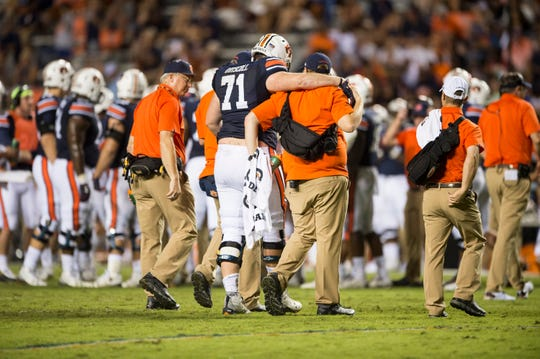 Auburn's Jack Driscoll (71) is helped off the field after suffering an injury against Southern Miss at Jordan-Hare Stadium in Auburn, Ala., on Saturday, Sept. 29, 2018. Auburn defeated  Southern Miss 24-13.