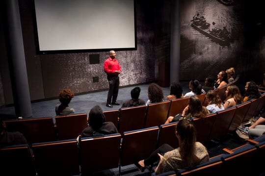Brad Bennett, a writer and editor for the SPLC speaks to a group of teenagers from South Africa and around the US at the Civil Rights Memorial Center in Montgomery, Ala., on Monday, Oct. 1, 2018. Sixteen teenage girls, from South Africa and the US are touring the south as a part of BRAVE, a South Africa-based organization that empowers, inspires and invests in girl leaders