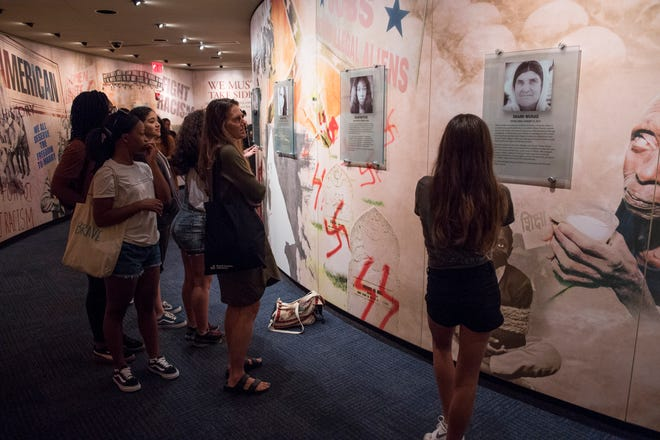 Teenagers from South Africa and around the US look through the exhibit at the Civil Rights Memorial Center in Montgomery, Ala., on Monday, Oct. 1, 2018. Sixteen teenage girls, from South Africa and the US are touring the south as a part of BRAVE, a South Africa-based organization that empowers, inspires and invests in girl leaders
