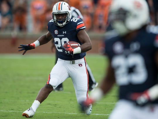 Auburn's Asa Martin (20) runs the ball down field against Southern Miss at Jordan-Hare Stadium in Auburn, Ala., on Saturday, Sept. 29, 2018. Auburn defeated  Southern Miss 24-13.