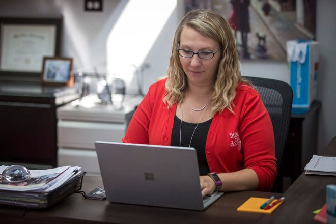 Tiffany Kerrigan, Vice President and Regional Director of ECI, works at her desk at the Muncie office of Little Red Door Cancer Agency. Little Red Door wants to increase both funding and clients by having better outreach with the community.
