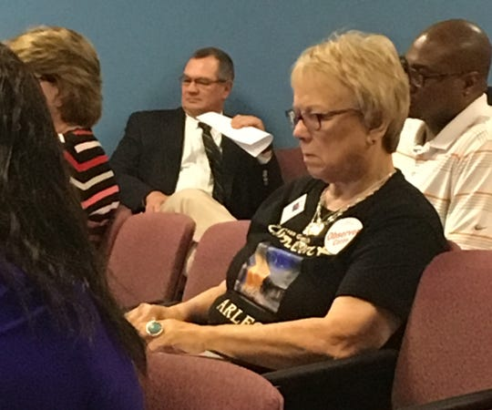David Day listens during a school board meeting this past summer.