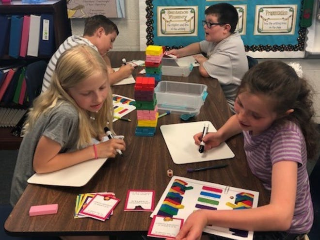 Fourth-grade students reinforce math and science skills through a building block game as part of a 2017-18 Robert P. Bell Education Grant.