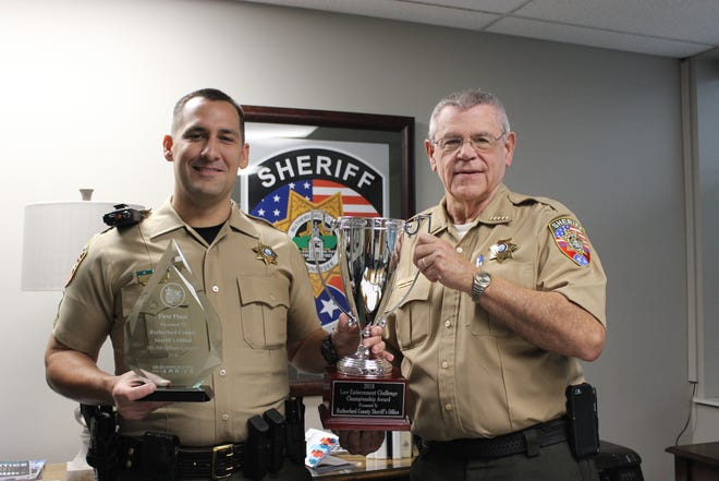 Cpl. Michael Rodgers displays to Sheriff Mike Fitzhugh awards the Tennessee Highway Safety Office presented to the Sheriff's Office.