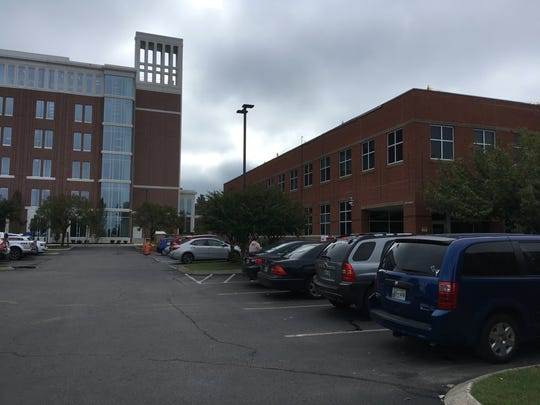 Parking for business at the Rutherford County Clerk, Register of Deeds and Property Assessor offices, right, can be a challenge because many are filling up spaces before heading to court in the new Judicial Center, left, officials report.