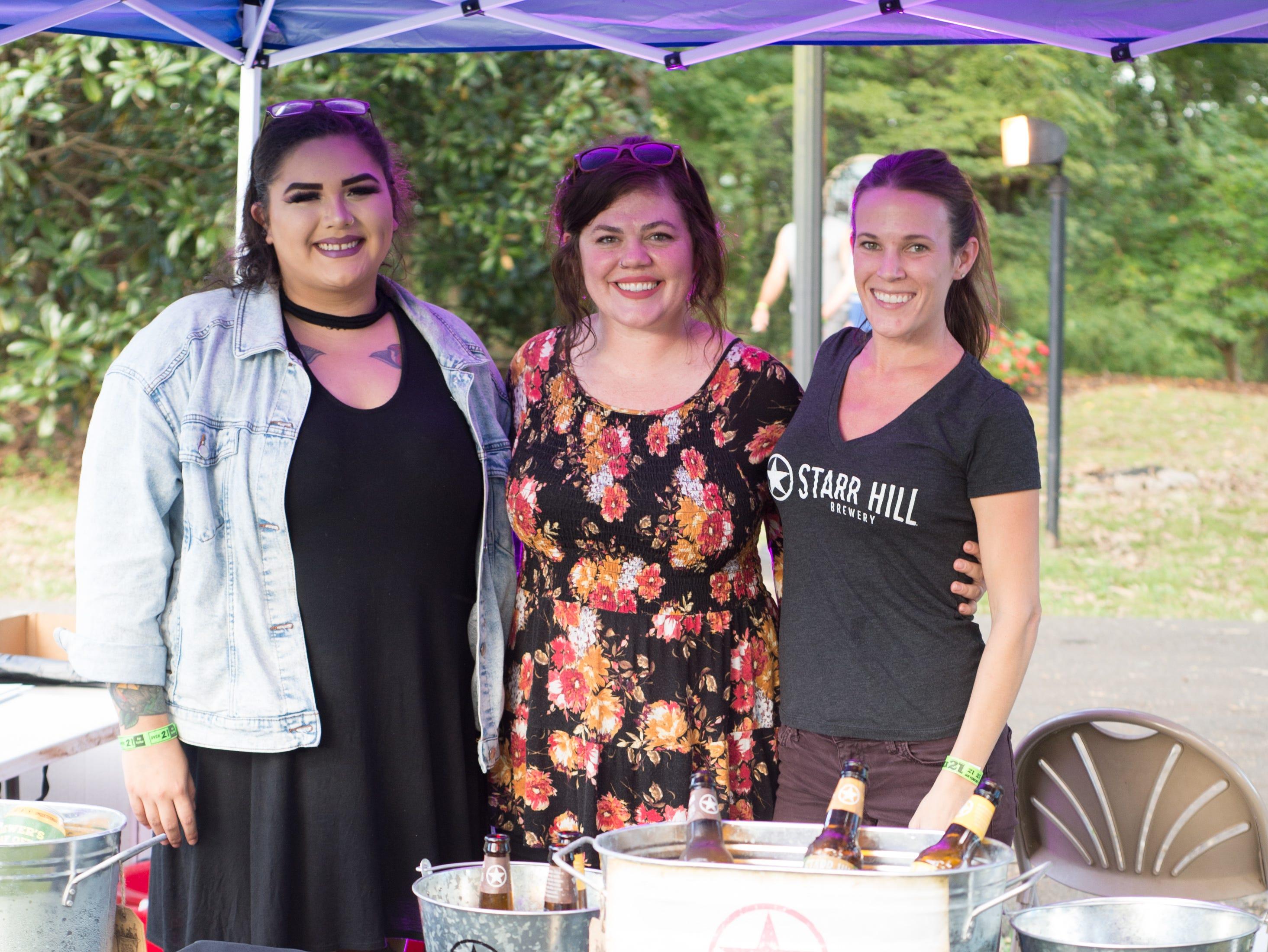True Miller, Melissa Gay and Kristen Meier participate in Oktoberfest at Oaklands Mansion in Murfreesboro on Saturday, Sept. 29.