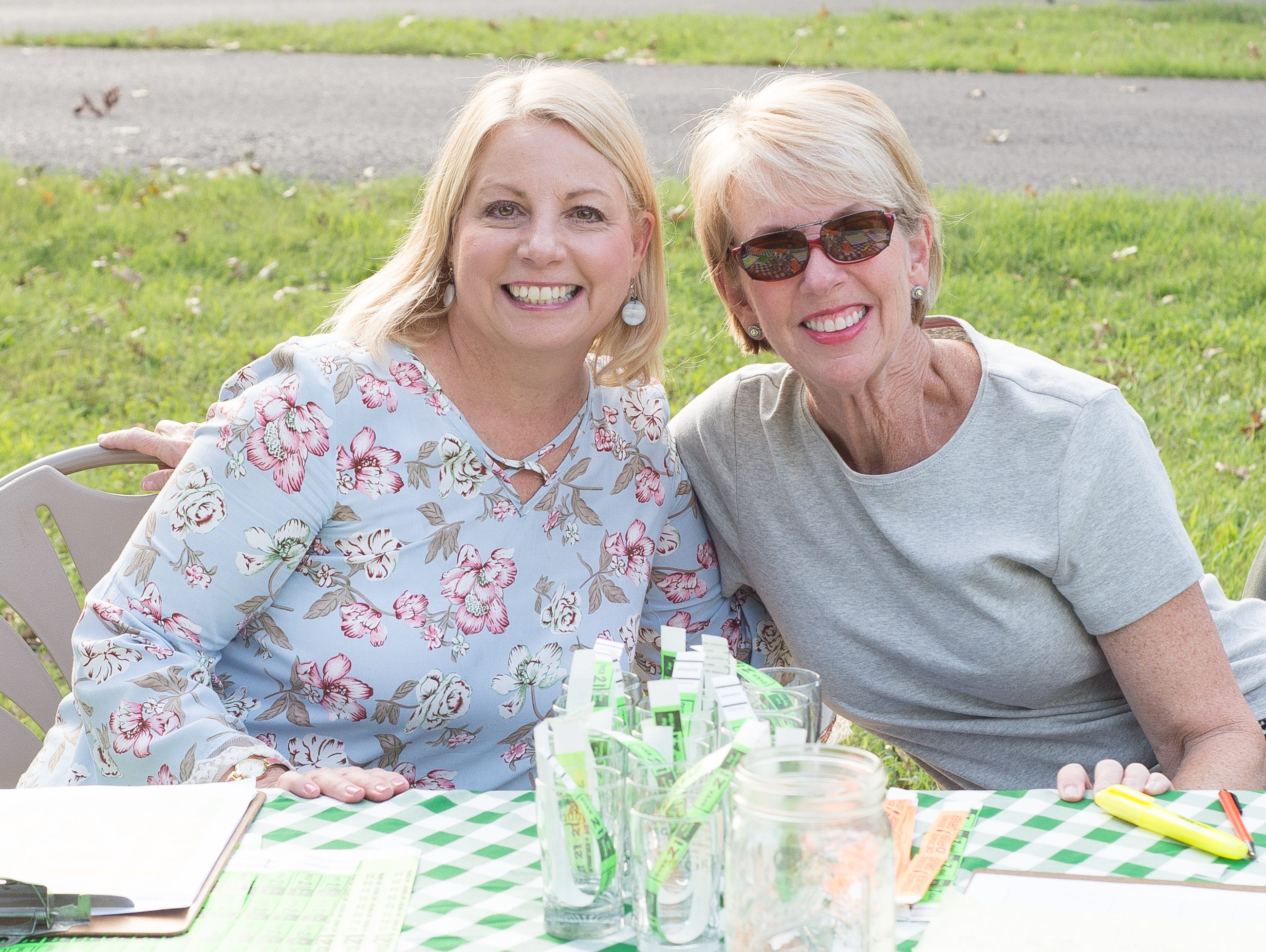 Karen Whitaker and Susan Grear help out during Oktoberfest at Oaklands Mansion in Murfreesboro on Saturday, Sept. 29.