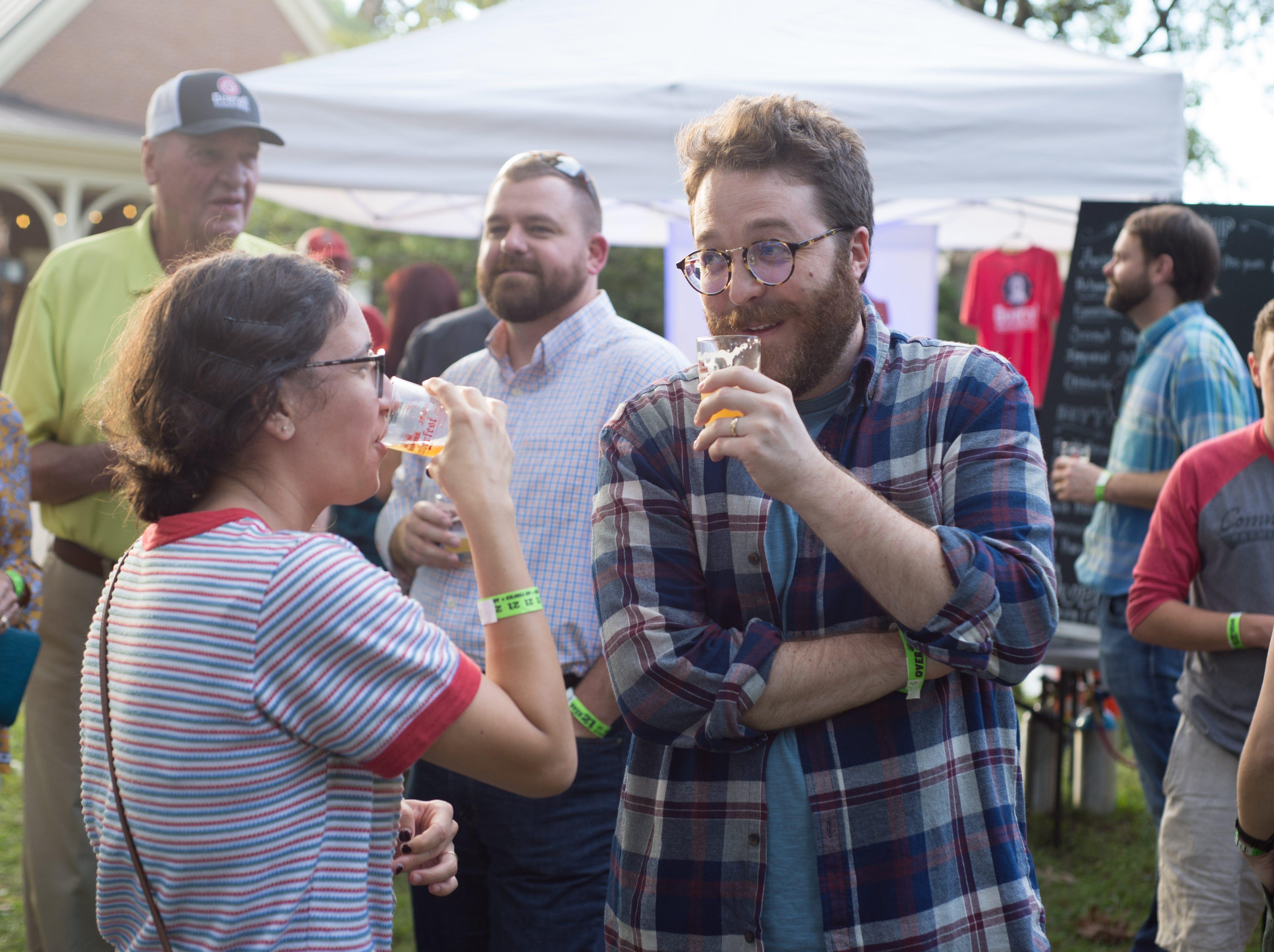 Lauren Gallina and Rob Wilson enjoy tasting samples during Oktoberfest at Oaklands Mansion in Murfreesboro on Saturday, Sept. 29.